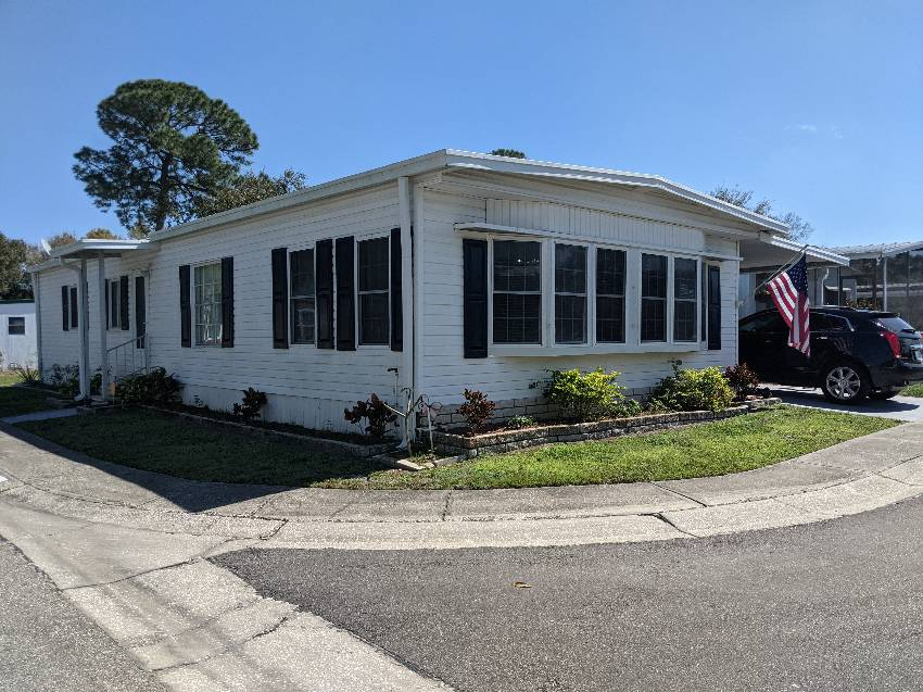 Clearwater, FL Mobile Home for Sale located at 15666 49th St N #1062 - Shady Lane Village