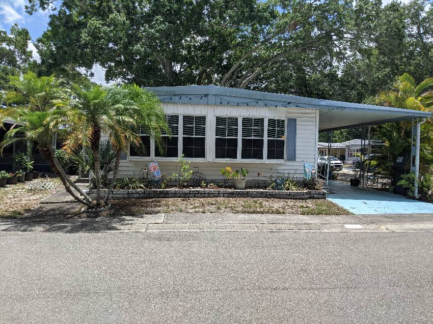 Clearwater, FL Mobile Home for Sale located at 15666 49th St N Lot 1155 - Shady Lane Village